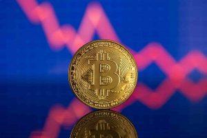 Moeda de bitcoin com gráfico ao fundo